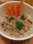 Risotto con prosciutto with sauteed onions and walnuts