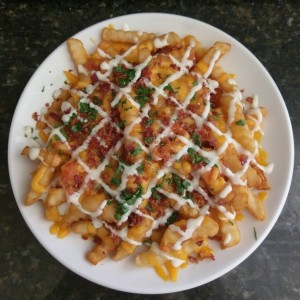 Loaded fries with bacon, chives, cilantro and ranch